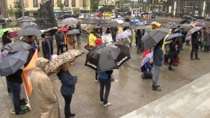 Parents, teachers, and students rallied in the rain outside Vancouver Art Gallery on Saturday. (CTV)