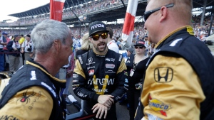 James Hinchcliffe, of Canada, talks with members of his crew before the 100th running of the Indianapolis 500 auto race at the Indianapolis Motor Speedway in Indianapolis, Sunday, May 29, 2016. (AP / Darron Cummings)