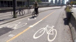 A cyclist uses a bike lane in Vancouver on Monday, May 30, 2016.