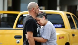 Ray Rivera, a DJ at Pulse Orlando nightclub, is consoled by a friend, outside of the Orlando Police Department after a shooting involving multiple fatalities at the nightclub, Sunday, June 12, 2016. (Joe Burbank/Orlando Sentinel / AP)