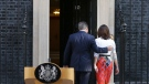 Britain's Prime Minister David Cameron puts his arm around his wife Samantha after speaking outside 10 Downing Street, London, Friday, June 24, 2016. Cameron says he will resign by the time of party conference in the fall after Britain voted to leave the European Union after a bitterly divisive referendum campaign, according to tallies of official results Friday. (Daniel Leal-Olivas/PA via AP)