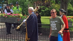 In this photo made available by Diamond Geezer, a man wearing an anti-immigration T-shirt walks during Armed Forces Day Parade in Romford, England on Saturday 25 June 2016. Britain's Prime Minister David Cameron and the Mayor of London Sadiq Khan warned Monday June 27, 2016 that abuse directed at immigrants wouldn't be tolerated, after a series of incidents were reported following the country's decision to leave the European Union. ( Diamond Geezer via The Associated Press)