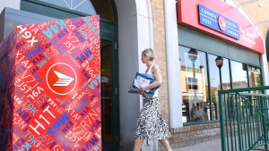A customer arrives at a Canada Post post office as an ongoing labour dispute between the Canadian Union of Postal Workers and Canada Post continues, on Tuesday, July 5, 2016 in Ottawa. (The Canadian Press/Justin Tang)
