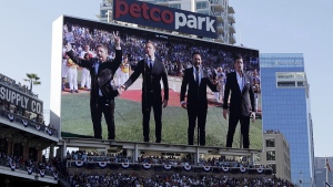 The Tenors, shown on the scoreboard, perform O Canada prior to the MLB baseball All-Star Game, in San Diego, Calif., on July 12, 2016. (AP / Gregory Bull)
