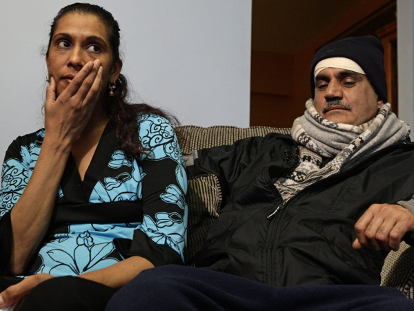Firoz Khan, right, who was allegedly beaten by three off-duty police officers while delivering newspapers in Vancouver last week sits with his wife Zabida as they speak with the media at their home in Surrey, B.C., on Tuesday January 27, 2009. (THE CANADIAN PRESS/Darryl Dyck)