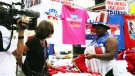 CTV News Chief Anchor Lisa LaFlamme peruses political paraphernalia for sale in Cleveland, Ohio, on Thursday, July 21, 2016. (Rosa Hwang)