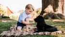 Prince George and the family dog Lupo are seen at Sandringham in Norfolk, England in this undated image released on Friday, July 22, 2016. (Matt Porteous / Handout)