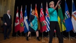 Ontario Premier Kathleen Wynne, right, B.C. Premier Christy Clark, centre, and Quebec Premier Philippe Couillard arrive to speak to the media during a meeting of premiers, in Whitehorse, Y.T., on Friday, July, 22, 2016. (THE CANADIAN PRESS/Jonathan Hayward)
