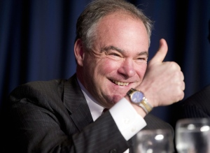 In this Feb. 4, 2016, file photo, Sen. Tim Kaine, D-Va., gives a 'thumbs-up' as he takes his seat at the head table for the National Prayer Breakfast in Washington. (AP / Pablo Martinez Monsivais, File)