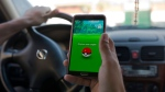 Vancouver police are warning drivers to put down their mobile phone games while behind the wheel. (AP / Amr Nabil)