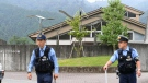 Police officers stand guard a facility for the handicapped where a number of people were killed and dozens injured in a knife attack Tuesday, July 26, 2016, in Sagamihara, outside Tokyo. (Kyodo News via AP)