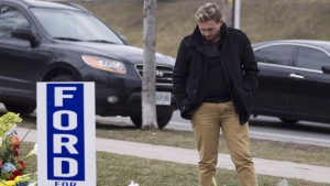 Michael Ford, the nephew of the late Rob Ford, looks at the flowers left at Douglas.B Ford Park in Etobicoke, on Wednesday, March 23, 2016. THE CANADIAN PRESS/Chris Young