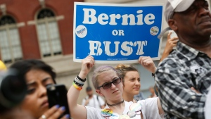 A supporter of Sen. Bernie Sanders, I-Vt., holds up a sign during a rally in Philadelphia, Thursday, July 28, 2016, during the final day of the Democratic National Convention. (AP Photo / John Minchillo)