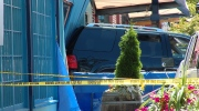One person is dead and two others are injured after an SUV crashed into a building on Granville Island. (CTV)