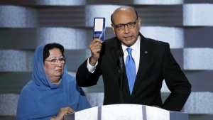 Khizr Khan, father of fallen US Army Capt. Humayun S. M. Khan holds up a copy of the Constitution of the United States as his wife listens during the final day of the Democratic National Convention in Philadelphia on Thursday, July 28, 2016. (AP / J. Scott Applewhite)