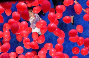 Democratic presidential nominee Hillary Clinton reaches toward the falling balloons at the conclusion of the Democratic National Convention in Philadelphia, Thursday, July 28, 2016. (AP / Mark J. Terrill)