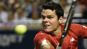 Milos Raonic returns the ball against Gael Monfilsduring men's quarter-final Rogers Cup tennis action in Toronto on Friday, July 29, 2016. (Nathan Denette / THE CANADIAN PRESS)