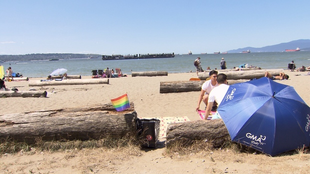 Crowds were already gathering at English Bay and Kitsilano beaches hours before noon on Saturday. (CTV)