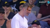 At a Pittsburg baseball game, a fan reaching for a foul ball was hit with a cheesy plate of nachos instead.