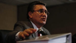 National Human Rights Commission President Luis Raul Gonzalez Perez Speaks during the presentation of a report about human rights abuses by Mexico's federal police, in Mexico City, Aug. 18, 2016. (AP / Moises Castillo)