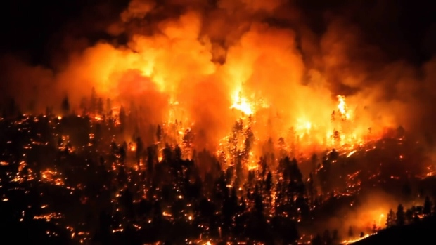 A wildfire on the west side of Okanagan Lake, about 10 kilometres north of West Kelowna, has forced the evacuation of 156 properties. (YouTube/Triple7Baby)