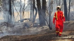 Volunteer firefighters' homes in path of wildfire