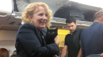 An Air Canada flight attendant holds a cat that managed to escape its carrier this week. Aug. 24, 2016. (Kath Thompson)