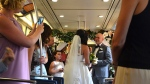 Nathaly and Jeff were married on a train at Stadium-Chinatown Station. (The Buzzer blog)