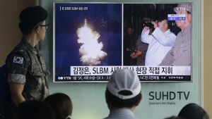 A South Korean army soldier watches a TV news program showing images published in North Korea's Rodong Sinmun newspaper of North Korea's ballistic missile believed to have been launched from underwater and North Korean leader Kim Jong-un, at Seoul Railway station in Seoul, South Korea on Thursday, Aug. 25, 2016. (AP / Ahn Young-joon)