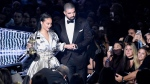 Rihanna, left, is escorted by presenter Drake after she accepted the Michael Jackson Video Vanguard Award at the MTV Video Music Awards at Madison Square Garden on Sunday, Aug. 28, 2016, in New York.(Photo by Chris Pizzello / Invision / AP)