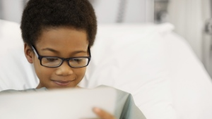 Children who played games on an iPad were as relaxed as those who took sedatives before undergoing general anesthetic. (francisblack / Istock.com)