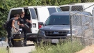 Los Angeles Police investigators arrive at singer Chris Brown's house in the Tarzana neighborhood of Los Angeles, Tuesday, Aug. 30, 2016. (AP / Damian Dovarganes)