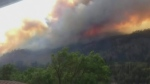 A wildfire is quickly growing in an area two kilom