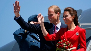 The Duke and Duchess of Cambridge wave from their plane before departing from their cross-Canada tour in Calgary, Alta., Friday, July 8, 2011. (Jeff McIntosh/THE CANADIAN PRESS)