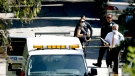 Investigators stand by the Los Angeles County coroners van after the body of a man was moved into it from a home in the Hollywood Hills section of Los Angeles, Friday, Sept. 23, 2016.  (AP Photo/Nick Ut)