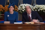 The Duke and Duchess of Cambridge sign the Canadian government's Golden Book at the Legislative Assembly in Victoria, B.C., on Saturday, September 24, 2016. (Jonathan Hayward / THE CANADIAN PRESS)