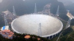 An aerial view shows the Five-hundred-meter Aperture Spherical Telescope (FAST) in the remote Pingtang county in southwest China's Guizhou province, Sunday, Sept. 25, 2016. (Chinatopix via AP)