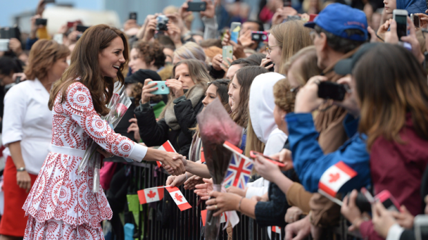 The Duchess of Cambridge greets well-wishers as she arrives at Jack Poole Plaza in Vancouver, B.C., Sunday, Sept. 25, 2016. (THE CANADIAN PRESS/Jonathan Hayward)