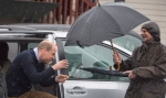 The Duke of Cambridge gets out of a vehicle to a waiting umbrella in Bella Bella, B.C., Monday, Sept 26, 2016. THE CANADIAN PRESS/Jonathan Hayward