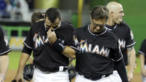 Miami Marlins' Martin Prado, left, walks off the field with manager Don Mattingly, right, after a baseball game against the New York Mets, Monday, Sept. 26, 2016, in Miami. (AP / Lynne Sladky)