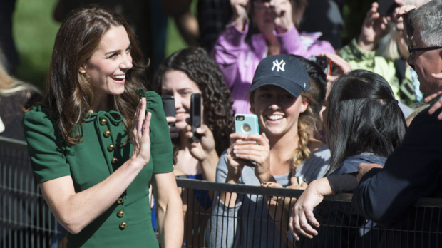 The Duchess of Cambridge waves to people at the University of British Columbia campus in Kelowna, B.C., Tuesday, Sept 27, 2016. THE CANADIAN PRESS/Jonathan Hayward