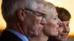 Catherine McKenna, centre, Minister of Environment and Climate Change, is flanked by Jim Carr, left, Minister of Natural Resources, and B.C. Premier Christy Clark after the federal government announced approval of the Pacific NorthWest LNG project in Richmond, B.C. Sept. 27, 2016. (THE CANADIAN PRESS/Darryl Dyck)