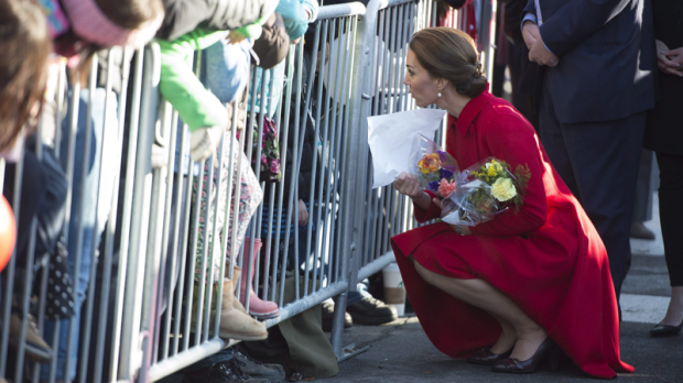 The Duchess of Cambridge leans down to talk to children at a Youth Arts Festival in Whitehorse, Yukon, Wednesday, Sept. 28, 2016. THE CANADIAN PRESS/Jonathan Hayward