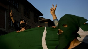 Kashmiri protesters holding a Pakistan occupied Kashmir flag shout slogans during a protest in Srinagar, Indian controlled Kashmir on Tuesday, Sept. 27, 2016. (AP / Dar Yasin)