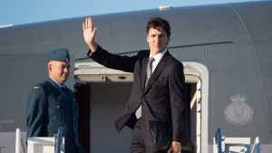 Canadian Prime Minister Justin Trudeau boards a government plane in Ottawa, Thursday September 29, 2016. Trudeau is heading to Israel for the funeral of former President of Israel, Shimon Peres, who died at the age of 93. (Adrian Wyld/THE CANADIAN PRESS)