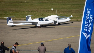 The world's first four-seater plane HY4 that uses emission-free hybrid fuel-cells to fly is pictured at the airport in Stuttgart, Germany, Thursday, Sept. 29, 2016. A 10-minute test flight Thursday at the airport in southwestern Germany involved two pilots and two dummy passengers. (Christoph Schmidt/AP)