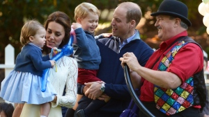 Prince William, and his wife Kate, the Duke and Duchess of Cambridge, take part in a tea party with their children, Prince George and Princess Charlotte, at Government House in Victoria, Thursday, Sept. 29, 2016. (THE CANADIAN PRESS/Jonathan Hayward)