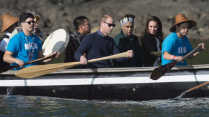The Duke and Duchess of Cambridge paddle with a group in a traditional Haida canoe in the waters of Haida Gwaii, Friday, Sept. 30, 2016. THE CANADIAN PRESS/Jonathan Hayward