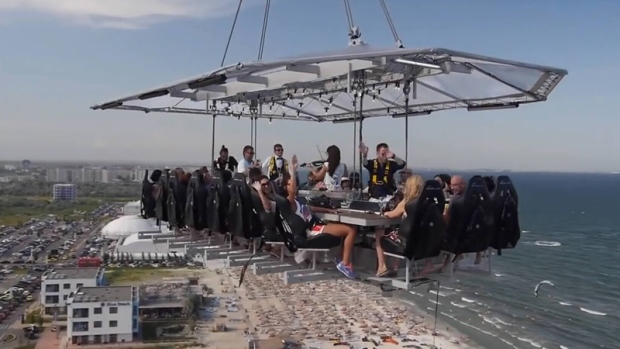 'Dinner in the Sky' serves up meals from a table suspended 45 metres in the air.