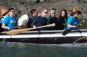 The Duke and Duchess of Cambridge paddle with a group in a traditional Haida canoe in the waters of Haida Gwaii, Friday, Sept. 30, 2016. (Jonathan Hayward / THE CANADIAN PRESS)